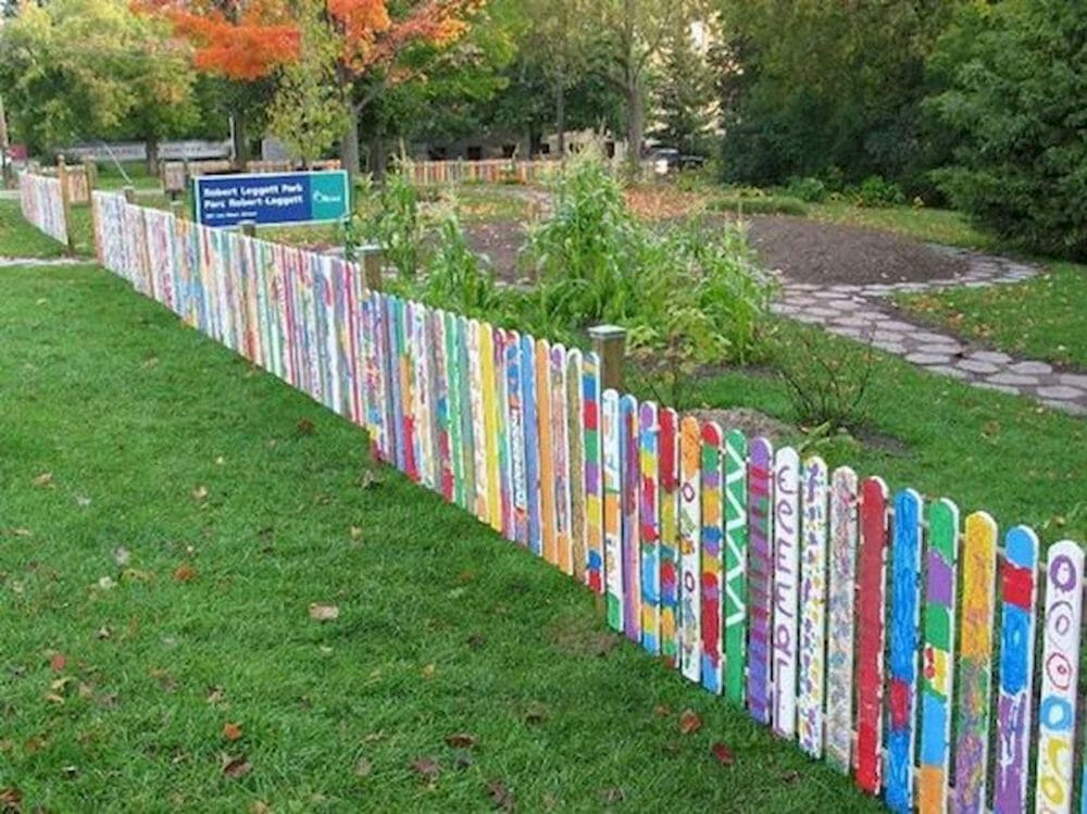 colorful painting fence posts purple