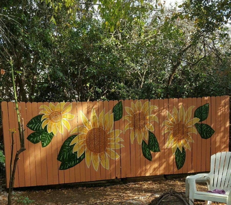 sunflower murals on wooden fences